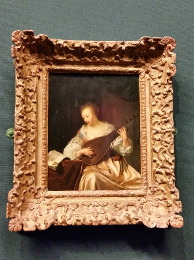 Frans Van Mieris the Elder - A woman playing a Lute 1