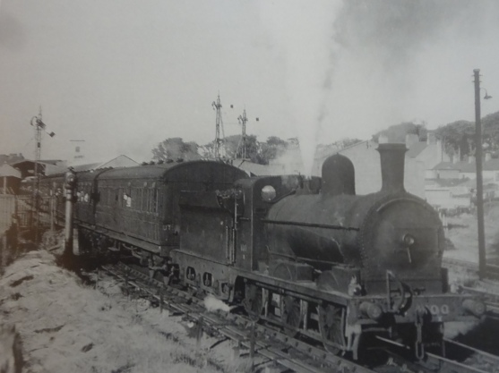 Number 100 pulls away from Bangor. Charles Friel collection
