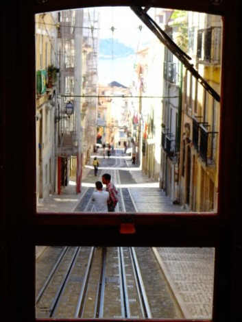 Inside Tram, Elevador da Bica, observing Portugese life and ready to go.