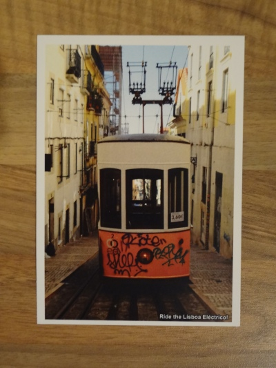 Design 3: Ride the Lisboa Eléctrico! Front of Audio Postcard. The Front card has a white borderline and it is labeled on the bottom right-hand corner.