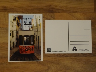 Design 3: Ride the Lisboa Eléctrico! The Front card has a white borderline and is labeled bottom right. The Back is blank with QR Code for scanning.