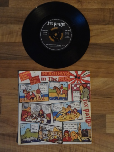 The Sex Pistols, Holidays in the Sun 7 Inch Vinyl Record.